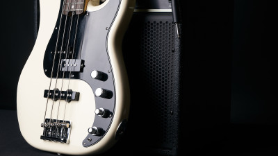 White electric guitar with amp