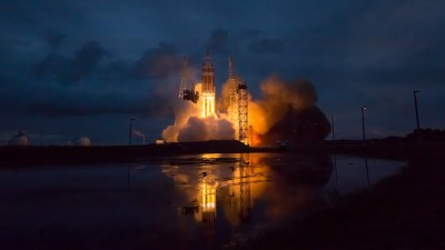 Rocket launches off from land during dusk