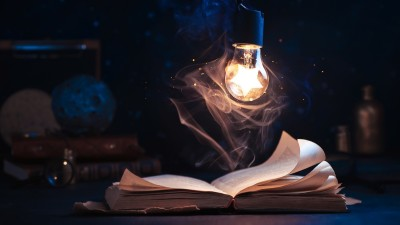 Star light bulb over book with dust