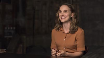 Natalie Portman sitting at table