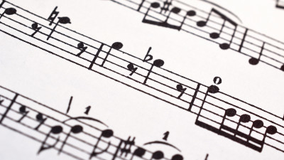 Close-up sheet music with flat note symbols