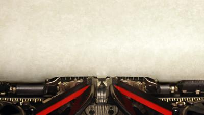 Blank piece of vintage paper in typewriter