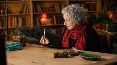 Margaret Atwood at desk writing