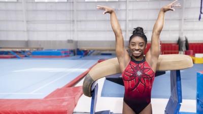 Simone Biles in front of gymnastics vault