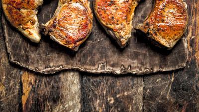 Pork chops on wood board