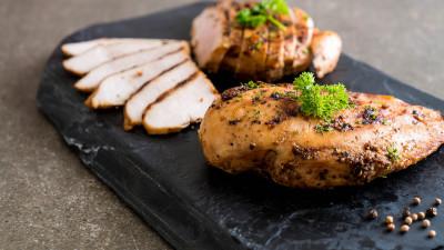 Chicken breast with sliced chicken on slate