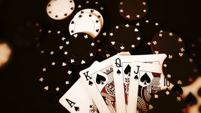 Black and white playing cards with poker chips