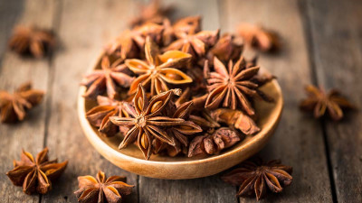 Star anise spice in wooden bowl