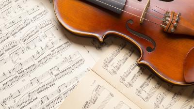 Violin on vintage music sheets