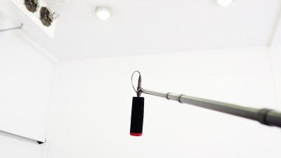 Microphone in white recording studio