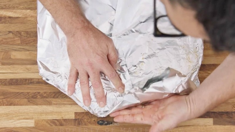 Aaron Franklin wrapping ribs in tinfoil step 4