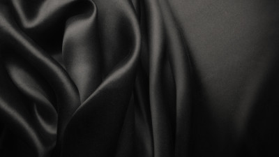 Black silk fabric in bunches