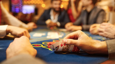 Person looking at playing cards at casino table