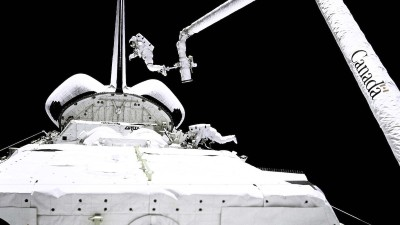 White Space ship in space with astronaut in background