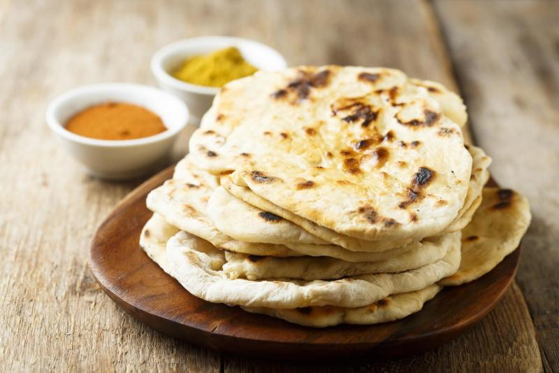 A stack of buttery naan
