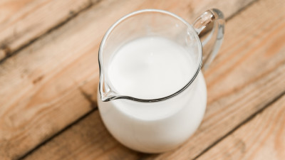 Milk in carafe on wood table
