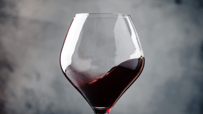 Red wine in glass with gray background