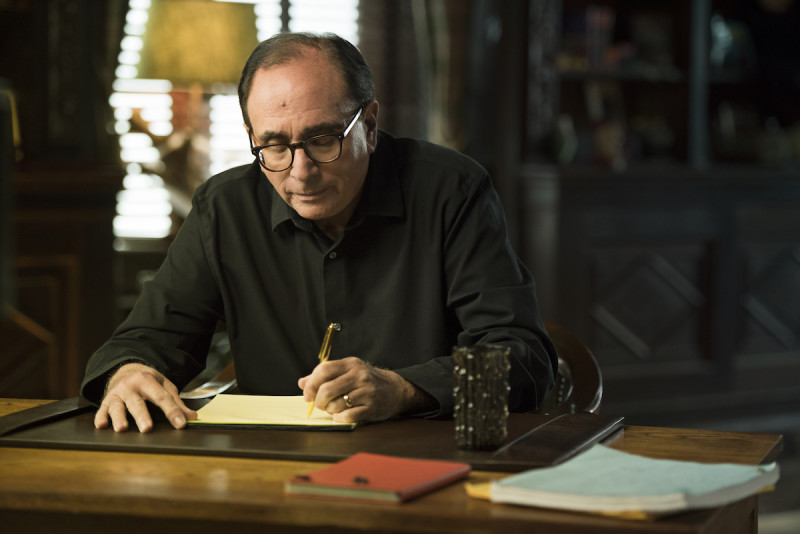 R.L. Stine writing at desk