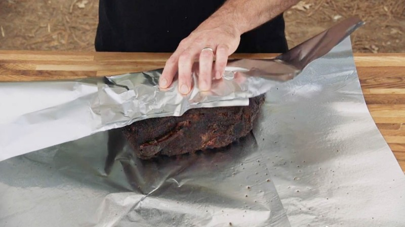 Aaron Franklin wrapping meat in tinfoil