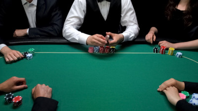 People sitting around a poker table