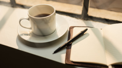 Notebook with coffee in window
