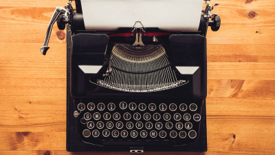 Typewriter with paper on wood