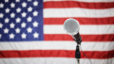 Microphone in front of an American flag