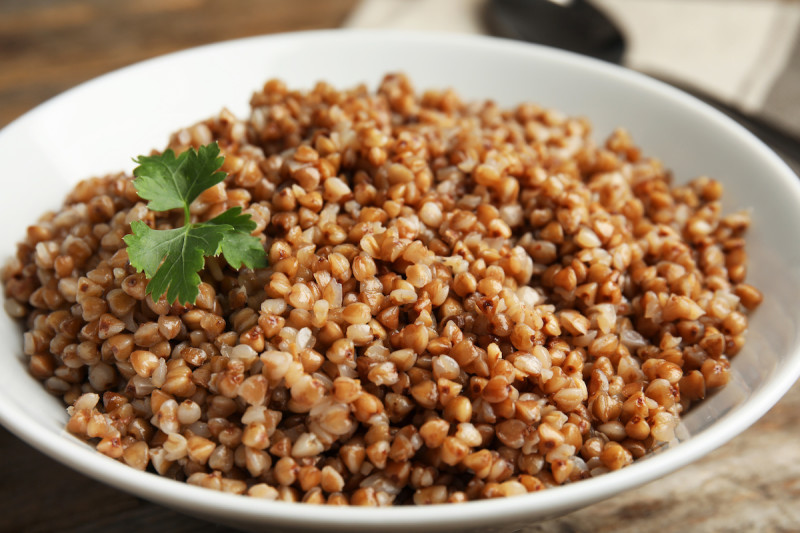 Cooked buckwheat in bowl with garnish