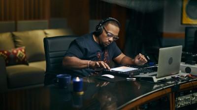 Timbaland in music studio producing beats on laptop