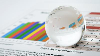 Glass globe ball on colorful charts