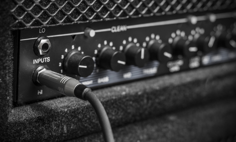 A guitar amp plugged in