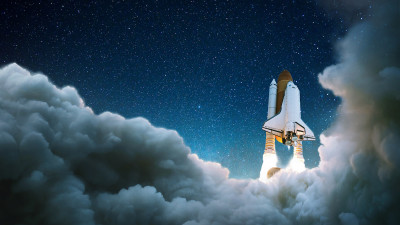 Rocket ship flying into space with clouds and stars