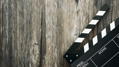 Movie clapper board on distressed wood