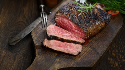 Prime rib on board with herb