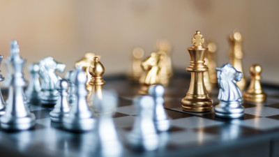 Gold and silver chess pieces on board