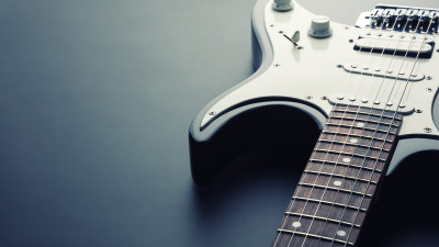 black and white electric guitar on black background