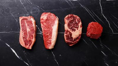 Varieties of raw meat on marble