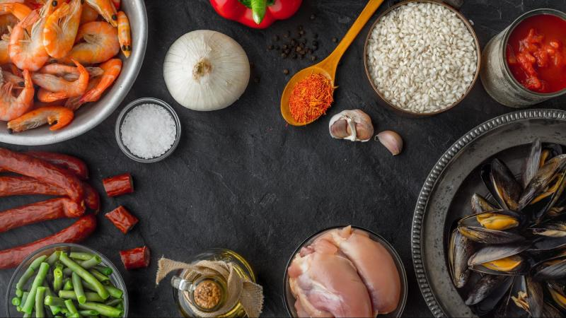 Ingredients for paella on black table