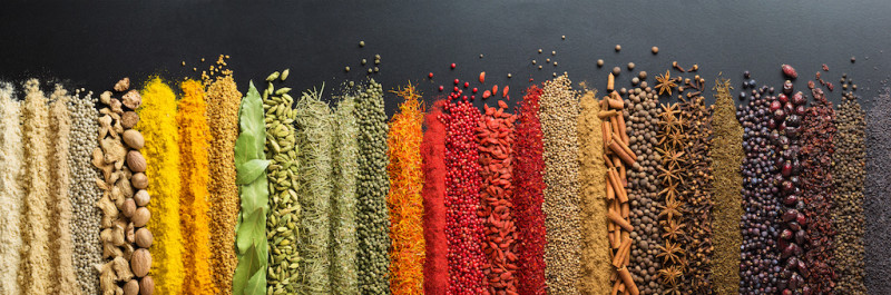 A table filled with colorful Indian Spices