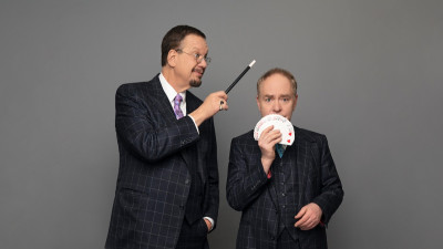Penn & Teller with magic wand and cards