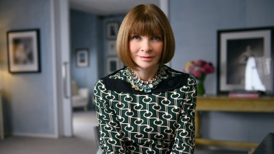 Anna Wintour sitting at chair in her office