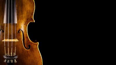 Wood violin upclose on black background