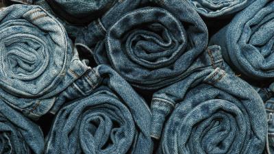 Rolls of different color denim jeans