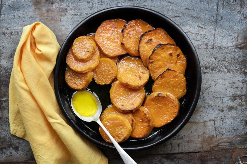 Sliced yams in an iron skillet