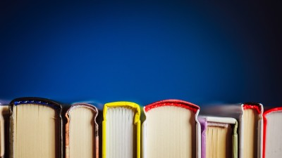 Colorful book spines on dark blue background