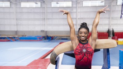 Simone Biles in front of a gymnastics vault