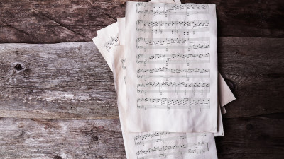 Vintage music sheets on rustic wood