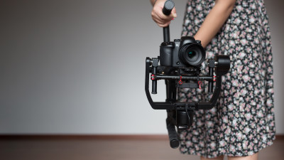 person holding steadicam and camera