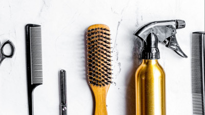 hair styling tools on marble background