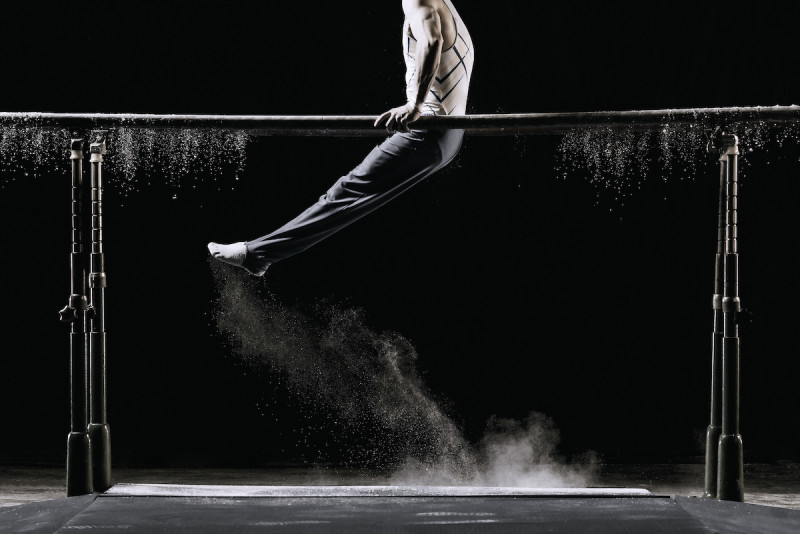 man on parallel bars in gymnastics